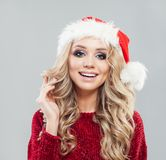 Christmas Woman. Beauty Model Girl In Santa Claus Hat Royalty Free Stock Images