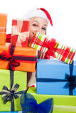 Christmas woman behind presents Stock Image