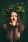Christmas woman blowing magical dust Royalty Free Stock Images