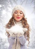 Christmas woman blowing snow Stock Photography