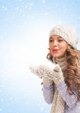 Christmas woman blowing snow Stock Photos