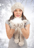 Christmas woman blowing snow Royalty Free Stock Photos