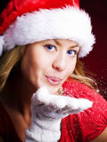 Christmas woman blowing starlight dust Royalty Free Stock Photos