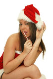 Christmas woman with candy cane stick Royalty Free Stock Images