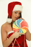 Christmas woman with candy Stock Photos