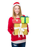 Christmas woman carry lots of gift box Stock Images
