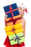 Christmas woman carrying presents Stock Photography