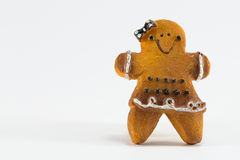 A Christmas woman cookie statuette with bow and skirt Royalty Free Stock Photography