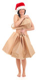 Christmas woman covering by bags Stock Images