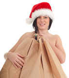 Christmas woman covering by bags Stock Photo