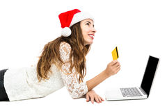 Christmas woman with a credit card looking to copy space Royalty Free Stock Photos