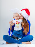 Christmas woman with cute baby. Royalty Free Stock Images