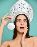 Christmas Woman. Cute Face. Healthy Skin. girl holds in her hand a Christmas tree ball. stock photography