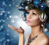 Christmas Woman with Decorated Hairstyle Blowing Kiss. Stock Photos