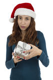 Christmas woman disappointed about the gift Stock Photography