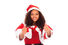Christmas woman doing a thumbs up gesture against a white backgr Stock Photos