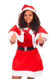 Christmas woman doing a thumbs up gesture against a white backgr Royalty Free Stock Photography