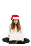 Christmas woman excited and looking to her computer Royalty Free Stock Image