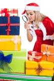 Christmas woman exploring present Stock Photography