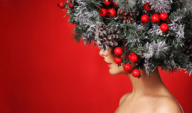 Christmas Woman. Fashion Girl with Decorated Hairstyle. Stock Photo