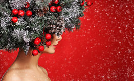 Christmas Woman. Fashion Girl with Decorated Hairstyle. Royalty Free Stock Image