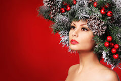 Christmas Woman. Fashion Girl with Decorated Hairstyle Stock Photography