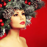 Christmas Woman. Fashion Girl with Decorated Hairstyle Stock Image