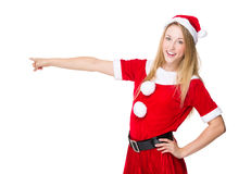 Christmas woman with finger point aside Royalty Free Stock Image