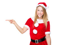 Christmas woman with finger point aside Stock Photos
