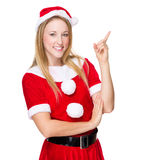 Christmas woman with finger point up Royalty Free Stock Photos