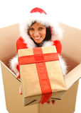 Christmas woman with gift Stock Photos