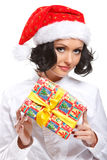 Christmas woman with gift. Portrait of happy christmas woman with gift box over white background Stock Images