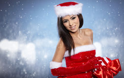 Christmas woman with gift, Royalty Free Stock Images