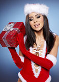 Christmas woman with gift, Royalty Free Stock Photos