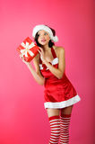Christmas woman with a gift Stock Images