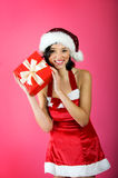 Christmas woman with a gift Royalty Free Stock Photos