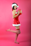 Christmas woman with a gift Stock Photos
