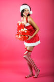 Christmas woman with a gift Stock Photo