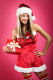 Christmas woman with a gift Royalty Free Stock Images
