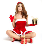 Christmas woman with gift Royalty Free Stock Photography