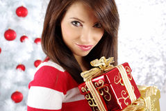 Christmas woman with gift box. Stock Photos