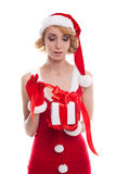 Christmas Woman with Gift Box. Beautiful Blonde Girl in Santa Ha royalty free stock images