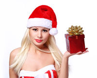 Christmas Woman with Gift Box. Beautiful Blonde in Santa Hat Royalty Free Stock Photography