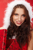 Christmas woman with a gift in her hands Stock Image