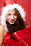 Christmas woman with a gift in her hands Royalty Free Stock Image