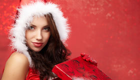 Christmas woman with a gift in her hands Stock Photo
