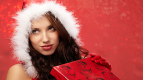 Christmas woman with a gift in her hands Stock Photos