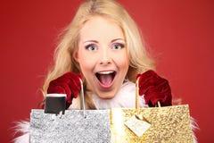 Christmas, woman and gift. Christmas, woman with two gift bags Stock Image