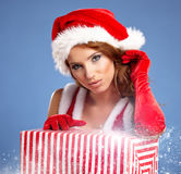 Christmas woman with gifts box Stock Image