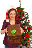 Christmas woman give a gift Royalty Free Stock Photo
